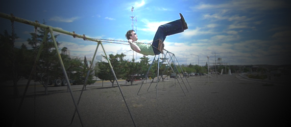 Colin Wright on a swing