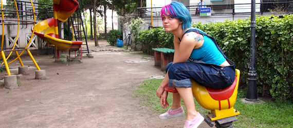 Jona riding a duck on a playground in Kolkata, India